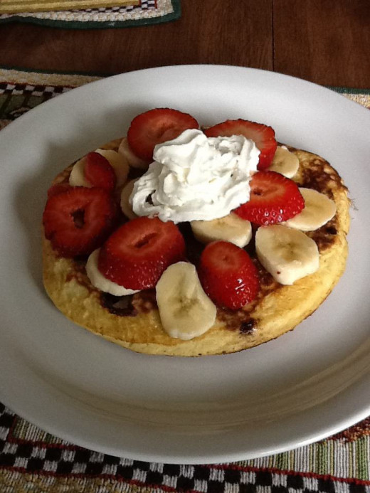 Pancakes in the morning with fruit.
