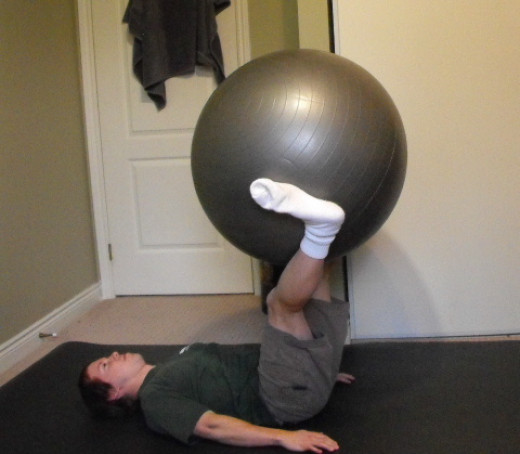 Me doing leg lifts with an exercise ball.