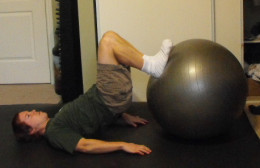 Me doing hamstring curls with a stability ball.