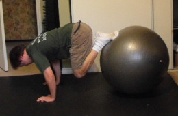 Me doing knee tucks on my exercise ball.