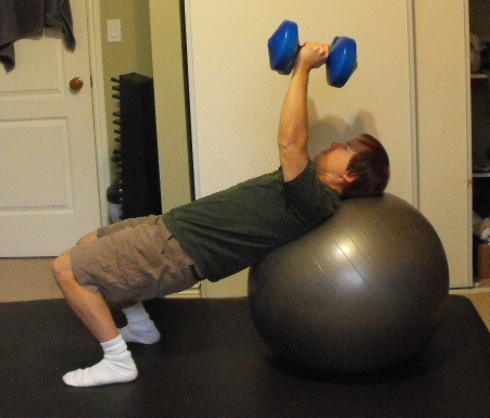 Me doing chest presses on my exercise ball.