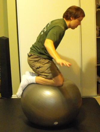 Balancing on an exercise ball.