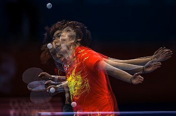 Table tennis is a sport where spin of the ball is essential element of a game.  (source: corbisimage.com)