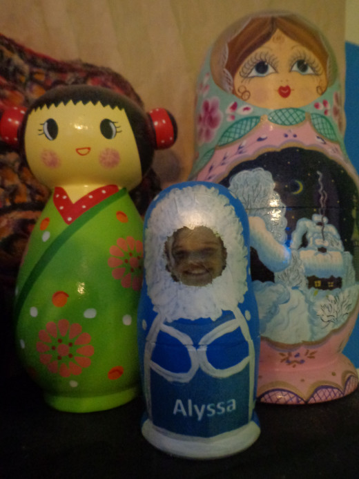 The little nesting doll in the middle was homemade but any nesting doll will work to hide money inside.