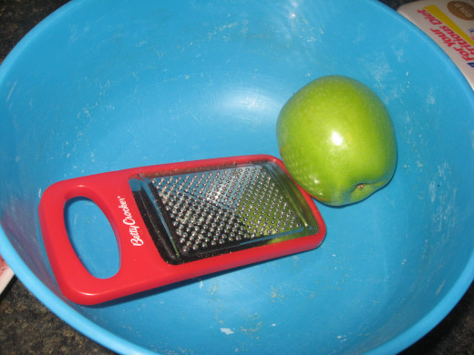 Grate or shred a tart apple.