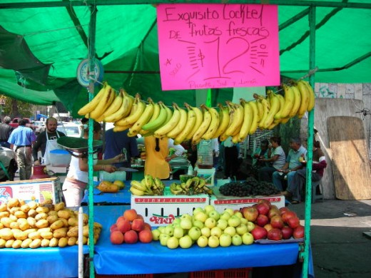 Bananas for sale on a stall.