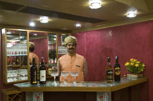 Bartender at the bar of Swarna Mahal dining car
