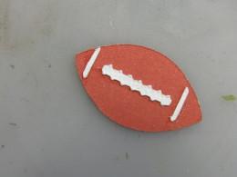 Football laces adhered