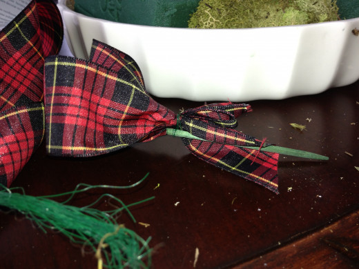 Loops of tartan ribbon, wired to a floral pick.