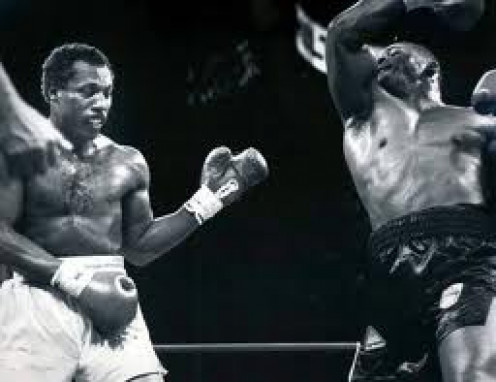 Iron Mike Tyson throws a right uppercut at Pinklon Thomas in their heavyweight championship bout.