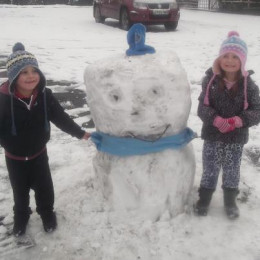 KRYSTAL AND RILEY PROUDLY SHOWING OFF THEIR SNOWMAN.