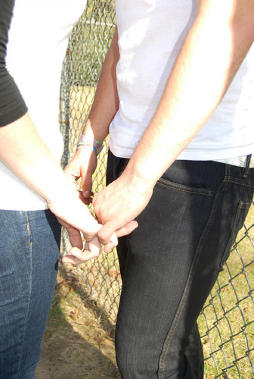 Touch between partners produces hormones that can cement a relationship.