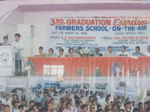 Travel Man as emcee on the Graduation Ceremonies of School-on-the-Air for farmers in Camarines Sur (Photo Source: Ireno Alcala)