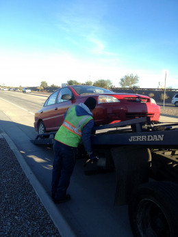 My Kia being pulled onto the Tow Truck
