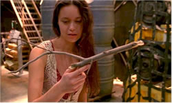 River Tam holding a gun, which in her mind appears as a twig.