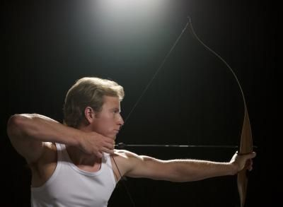 This man is shooting a traditional bow. As you can see it requires more effort than a compound bow.