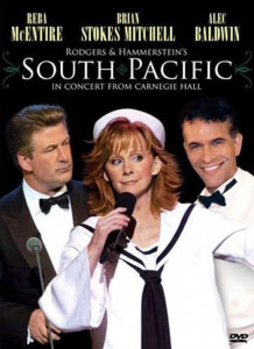 This is a low resolution image of the DVD cover for the 2005 concert version of South Pacific, covered by the fair use doctrine under US copyright law. Pictured are Alec Baldwin, Reba McEntire, and Brian Stokes Mitchell.