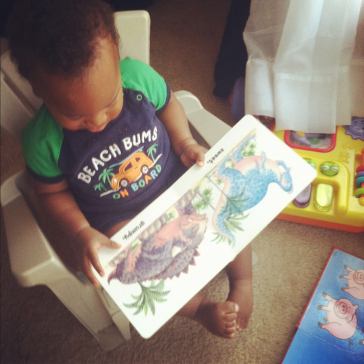11 months and already enjoying a book by himself.