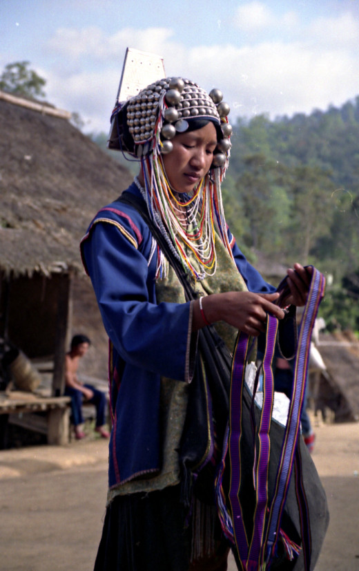 Akha Hill tribe woman with handicrafts for sale