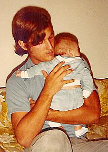 David and his infant son in 1980