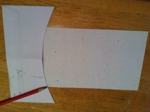 Cut a slight curve on one end.  I used a junk mail envelop to make a pattern for the curve.
