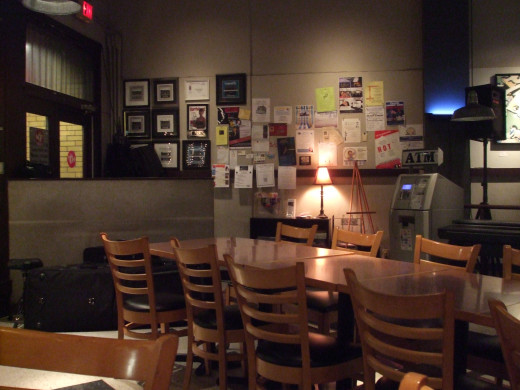 The rearrangemt of 4-top tables into a row for the audience at MJ's Coffee House.