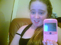 My Daughter Jennifer shows off her Cell Phone. It had to be pink or we would have had to return it to the store.