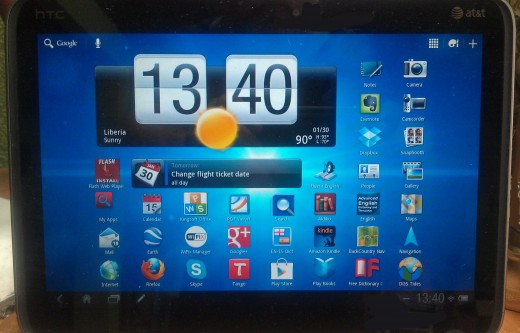 The central, or home screen, of the HTC Jetstream with the standard background theme.  Apps, personalizion options and widgets are accessed in the upper right corner.  Settings and notices are accessed in the lower right corner.