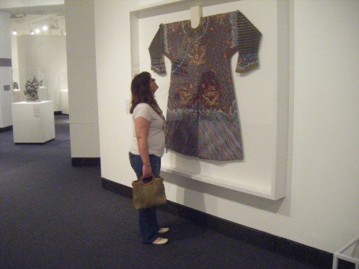 Silk-embroidered court robe, Chinese, Qing Dynasty, being admired by my wife