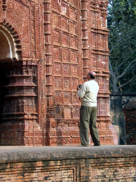My wife clicked while I was studying the panels of West pwall of RamChandra temple.