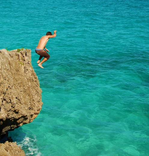 When jumping into strange waters, for safety, always jump feet first, as it is difficult to judge depth and objects that are under the water.  This pic is taken at Navio Beach in Vieques.