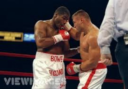 Riddick Bowe and Andrew Golota wage war in the ring. The two boxers fought twice with Golota losing by DQ in both bouts.