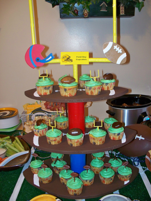 Football shaped cupcake tower loaded with cupcakes