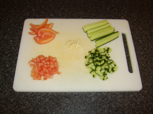 Chopping the cucumber salsa ingredients