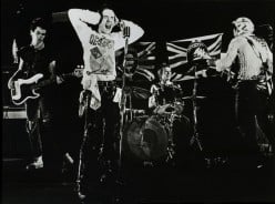 By Sex_Pistols_GSTQ_Promo.jpg: Warner Bros. (corporate author); unknown photographer derivative work: Benzband (Sex_Pistols_GSTQ_Promo.jpg) [Public domain], via Wikimedia Commons
