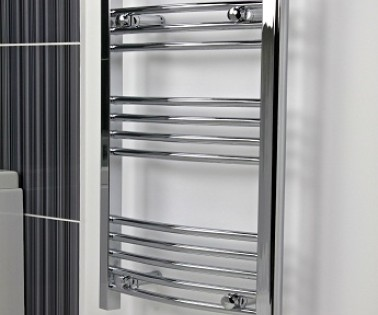 A shiny chrome towel radiator