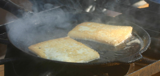 In under two minutes, when the cheese is brown on one side, flip it over