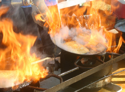 The fire leaps from the pan