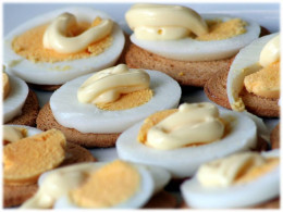 """For """"fancier"""" deviled eggs, slice thinner and place on top of a bagel cracker."""