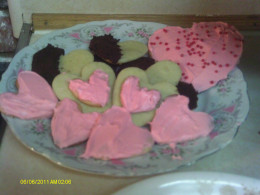 A plate full of Valentine sugar cookies