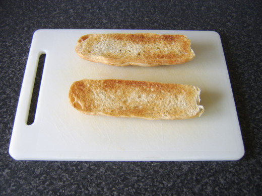 A fresh sub roll is lightly toasted