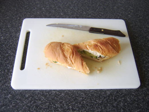 The sub roll is cut in half to serve