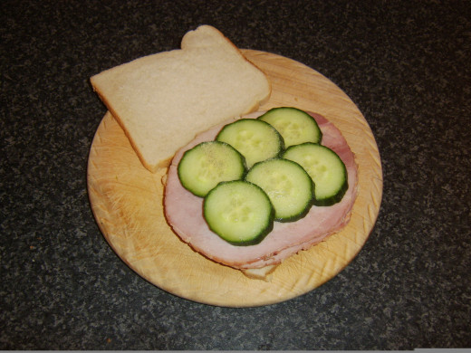 Cucumber is laid on hamd and seasoned