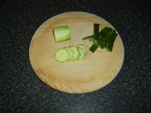 Cucumber is skinned before being very thinly sliced