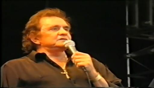Johnny Cash singing at the Glastonbury Festival in England in 1994.  He would later regard his appearance as one of the great highlights of his musical career.