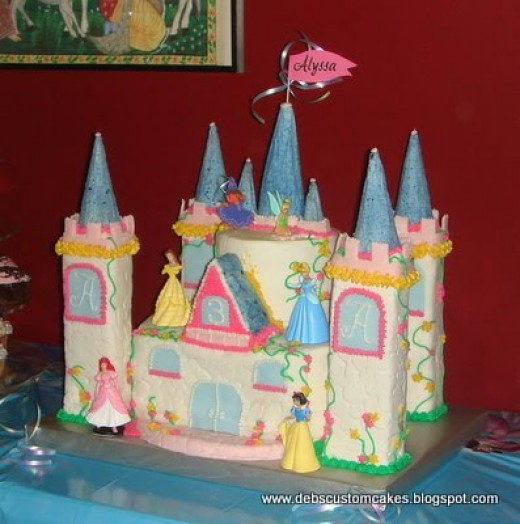 One of my more complex cakes, a few years after I started. (everything, but princesses and flag, are edible)