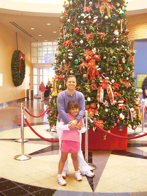 My daughter and I in the Lobby of Pop Century during one of our November trips. Its awesome because they have everything decorated for Christmas.