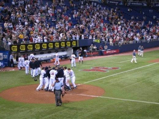 The Minnesota Twins celebrate an extra innings, walk off home run by Justin Morneau.