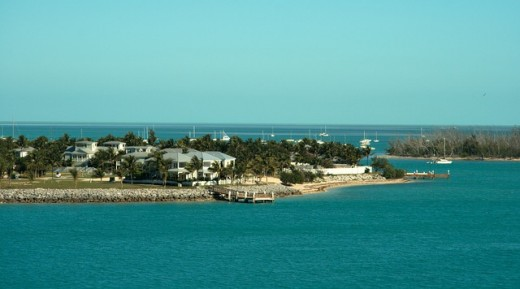 The island of Key West is at the southernmost tip of the Florida keys and about 90 miles from Cuba.  It is about 4 miles wide.  Its total land mass is 4.2 square miles.  The city of Key West is the most populated city in the Florida Keys.