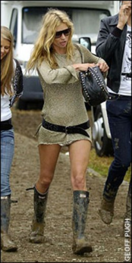 Kate Moss at Glastonbury in her omnipresent Hunter boots.